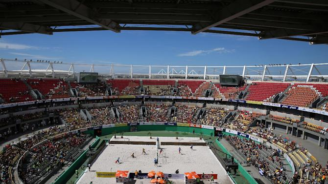 Cerutti and Schimit of Brazil play against Dalhausser and Lucena of the U.S during a beach volleyball friendly match at the Olympic Tennis Centre, in Rio de Janeiro