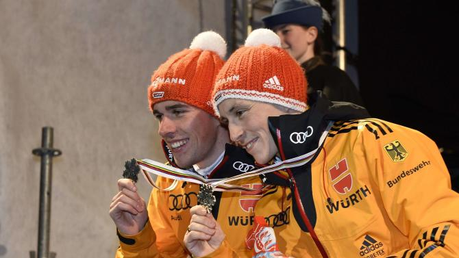 Medallists pose on the podium after their Nordic Combined 2x7,5 km team sprint competition of the FIS Nordic Skiing World Championships in central Falun