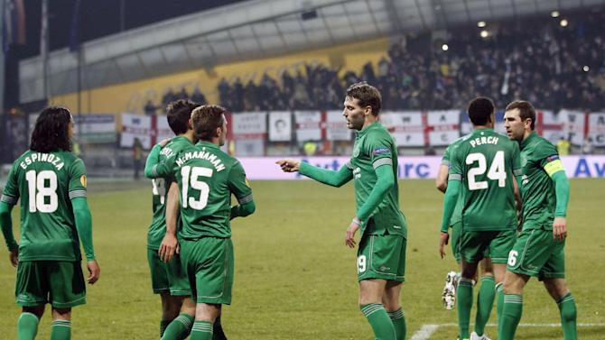 Wigan players celebrate their opening goal against Maribor, during their group D Europa League soccer match, in Maribor, Slovenia, Thursday, Dec. 12, 2013