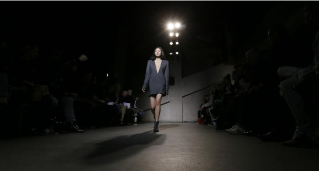 A model presents a creation by designer Delouis and creative director Mannerheim as part of their Autumn/Winter 2015/2016 women's ready-to-wear collection for Each x Other during Paris