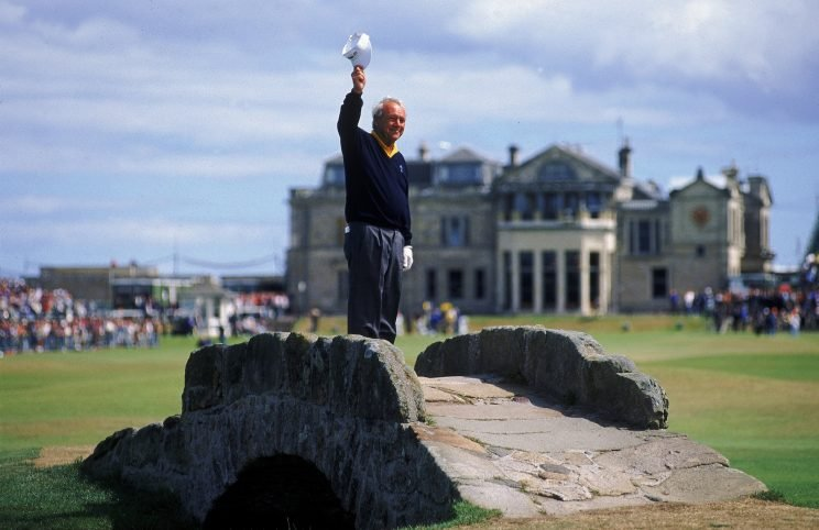Arnold Palmer of the USA waves to the crowd from the Swilken Bridge on the 18th hole during the second round of the British Open at St Andrews in Scotland. This proved to be a farewell from Palmer as shortly after the round he announced this would be his last British Open appearance.