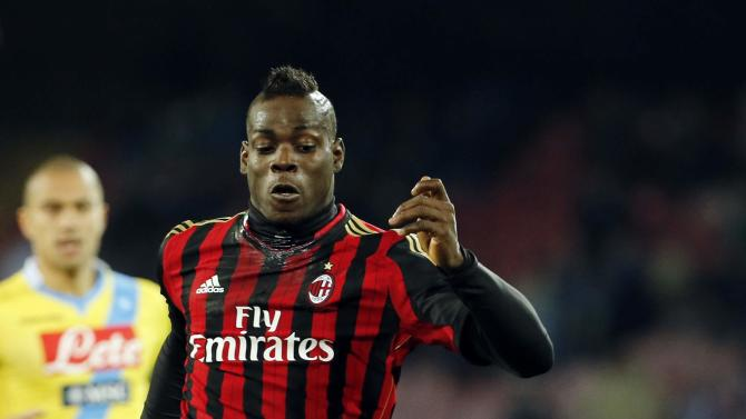 AC Milan's Balotelli controls the ball during their Italian Serie A soccer match against Napoli in Naples