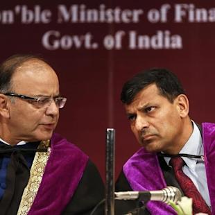 India's Finance Minister Arun Jaitley speaks to Reserve Bank of India Governor Raghuram Rajan during convocation ceremony for students at a university in Mumbai