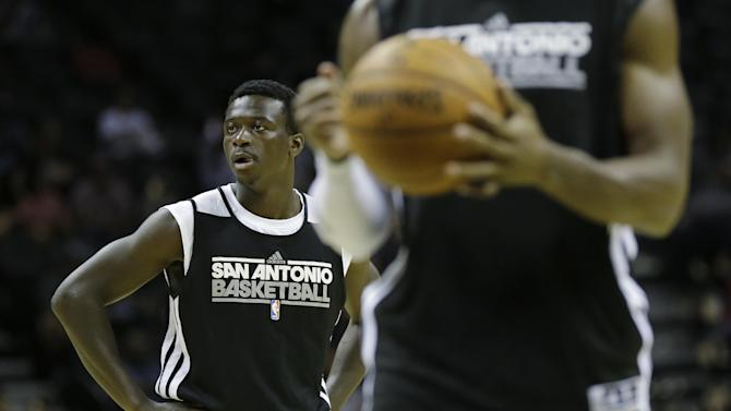 San Antonio Spurs' Myck Kabongo, left, takes park in a scrimmage during an open NBA basketball practice, Sunday, Oct. 6, 2013, in San Antonio