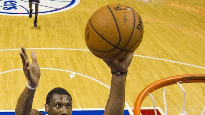 Philadelphia 76ers' Thaddeus Young puts up the shot during the third quarter of a preseason NBA basketball game against the Brooklyn Nets, Monday, Oct. 14, 2013, in Philadelphia.  The Nets won 127-97