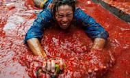 La Tomatina Festival: Spain Town Charges