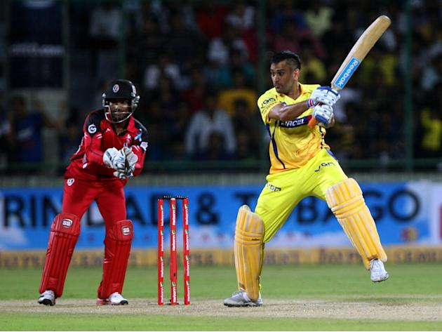 CSK captain MS Dhoni plays a shot during the CLT20 match between Chennai Super Kings and Trinidad & Tobago at Feroz Shah Kotla, Delhi on Oct. 2, 2013. (Photo: IANS)