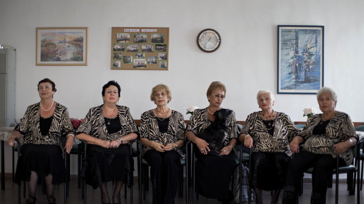 In this Nov. 4, 2012 photo, a choir practices in a government-funded elderly care facility catering to Russian-speaking immigrants in Ashdod, southern Israel. The choir sings Russian standards and Israeli folk songs translated into Russian. (AP Photo/Oded Balilty)