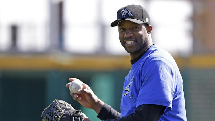 In this Feb. 12, 2014, photo, retired NBA basketball player Tracy McGrady smiles while working out at the Sugar Land Skeeters' baseball stadium in Sugar Land, Texas. McGrady signed Wednesday, April 23, to pitch for the Skeeters in the independent Atlantic League