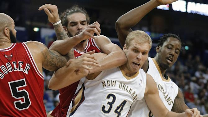 Chicago Bulls center Joakim Noah reaches over the back of New Orleans Pelicans center Greg Stiemsma (34) during the second half of an NBA basketball game in New Orleans, Saturday, Feb. 1, 2014. The Pelicans defeated the Bulls 88-79