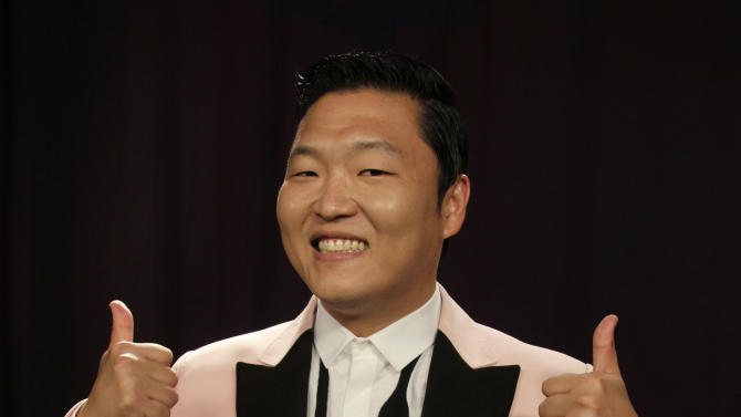 "This Aug. 22, 2012 photo shows South Korean rapper PSY posing for a photo in New York. His ""Gangnam Style"" video has more than 200 million YouTube views and counting, and it's easy to see why. Gangnam is only a small slice of Seoul, but it inspires a complicated mixture of desire, envy and bitterness. It's also the spark for PSY's catchy, world-conquering song. (AP Photo/John Carucci)"