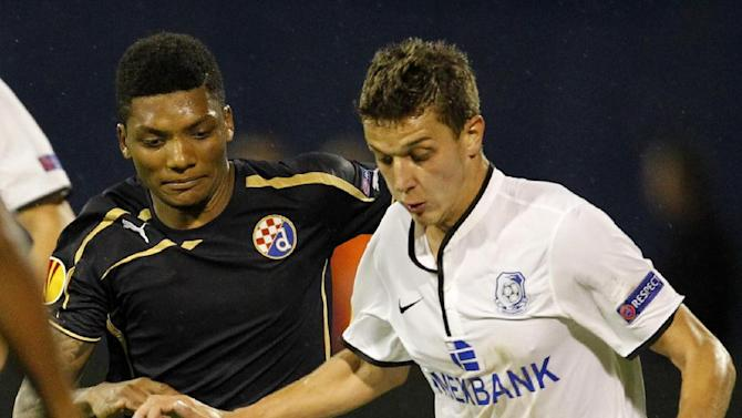 Chornomorets Odessa's  Ivan Bobko, right, is challenged by Dinamo Zagreb's Junior Fernandes during their Europa League soccer  match, in Zagreb, Croatia, Thursday, Sept. 19, 2013