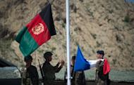 Afghan National Army soldiers raise their national flag next to the French flag during a transition ceremony at Surobi base on April 12, 2012. The French army handed the district of Surobi to the Afghan army as part of the gradual transition of the country's security to Afghan forces