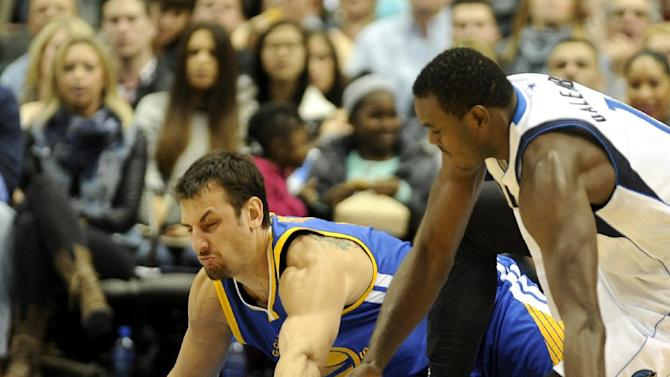 Golden State Warriors center Andrew Bogut, left, and Dallas Mavericks center Samuel Dalembert go after a loose ball in the first half during an NBA basketball game on Wednesday, Nov. 27, 2013 in Dallas