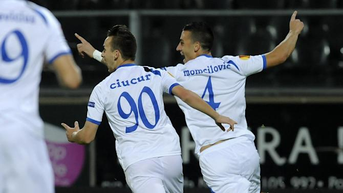 Pandurii's Marko Momcilovic, from Serbia, right, celebrates scoring against Pacos Ferreira with teammate Alexandru Ciucur during their Europa League Group E soccer match at the D. Afonso Henriques Stadium, in Guimaraes, Portugal, Thursday Oct. 3, 2013