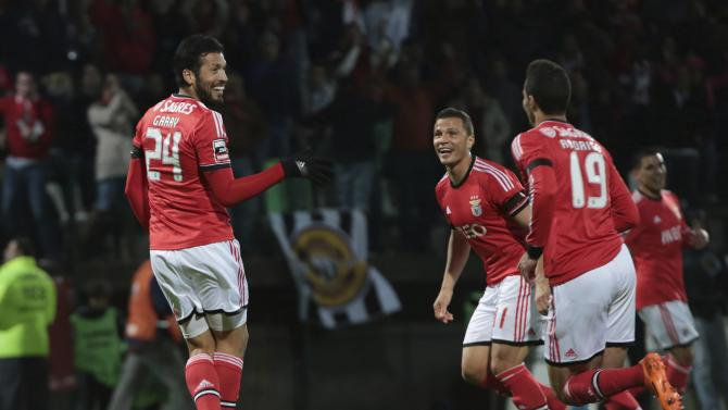 Benfica's Ezequiel Garay celebrates his goal with his teammates during their Portuguese Premier League soccer match against Nacional at Choupana stadium in Funchal