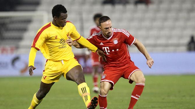 Bayern Munich's Franck Ribery, right, of Munich and Bazziro Bamba of Al-Merrikh vie for the ball, during the international friendly soccer match between Al Merreikh SC and Bayern Munich, at Al-Sadd Stadium in Doha, Qatar, Thursday, Jan. 9, 2014