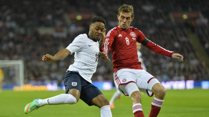 England's Sterling challenges Denmark's Poulsen during their international friendly soccer match at Wembley stadium in London