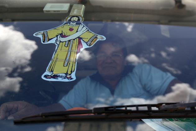 A sticker of Jesus decorates the windshield of a truck parked on a federal highway during a truckers strike in Goiania, Brazil, Wednesday, Feb. 25, 2015. Weeklong protests by Brazilian truckers demand
