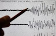 A scientist points to the seismograph of a major earthquake. A shallow 6.3-magnitude earthquake has rattled western China, on the border between Xinjiang and Tibet, the US Geological Survey says