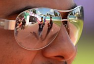 Participants are reflected in sunglasses during the opening ceremony of the first South Asia Lesbian, Gay, Bisexual and Transgender Sports Festival in Kathmandu on Friday