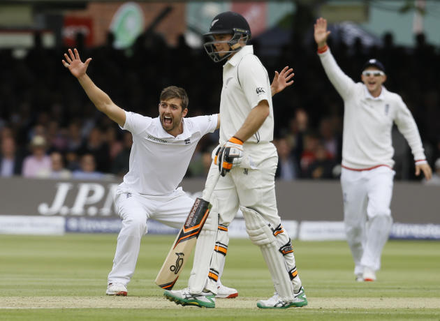 England's Mark Wood, left makes an unsuccessful appeal for lbw on New Zealand's Martin Guptill during play on the second day of the first Test match at Lord's cricket ground in London, Fri
