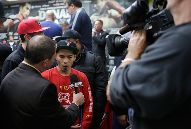 HOUSTON, TX - DECEMBER 14: Nonito Donaire of the Philippines is interviewed on stage at his official weigh-in at PlazAmericas Mall a day prior to his fight with Jorge Arce of Mexico on December 14, 2012 in Houston, Texas. (Photo by Scott Halleran/Getty Images)