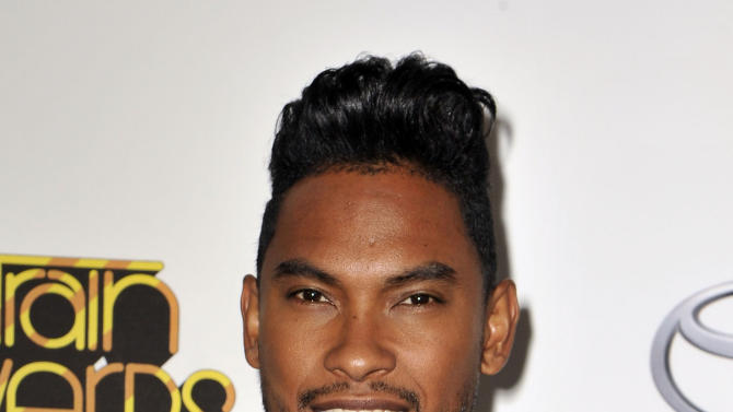 "FILE - In this Thursday, Nov. 8, 2012 file photo, Miguel arrives at the Soul Train Awards at Planet Hollywood Resort and Casino in Las Vegas. Miguel is up for five Grammy Awards, including song of the year for his crossover hit, ""Adorn.""  (Photo by Jeff Bottari/Invision/AP, File)"