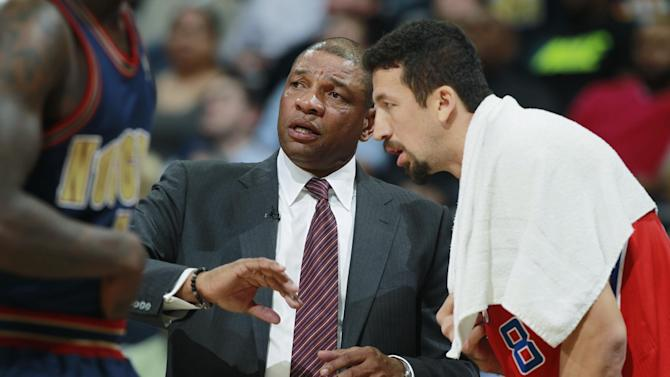 Los Angeles Clippers head coach Doc Rivers, left, confers with forward Hedo Turkoglu, of Turkey, before the player took the court to face the Denver Nuggets in the fourth quarter of the Nuggets' 110-100 victory in an NBA basketball game in Denver on Monday, March 17, 2014