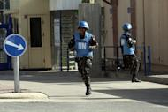 Filipino UN peacekeepers cross the Quneitra checkpoint between Israel and Syria in the Golan Heights on March 9, 2013. A group of 21 UN peacekeepers seized by Syrian rebels on the Golan were still being held on Saturday after a two-hour truce during which their release had been expected, a watchdog said