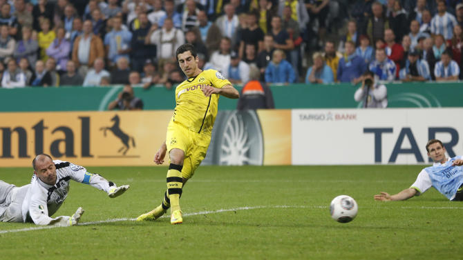 Dortmund's Henrikh Mkhitaryan of Armenia scores his side's second goal during the German soccer cup second round match between TSV 1860 Munich and Borussia Dortmund, in Munich, southern Germany, Tuesday, Sept. 24, 2013