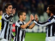 Juventus's Sebastian Giovinco (C) celebrates with teammates Andrea Pirlo (R) and Alessandro Matri during a Champions League on November 7. Juventus's hopes of being among the last 16 could be decided by their clash against Chelsea on Tuesday