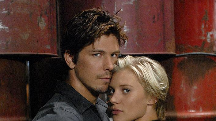 "Michael Trucco and Katee Sackhoff star as Anders and Kara ""Starbuck"" Thrace in Battlestar Galactica on the Sci Fi Channel."
