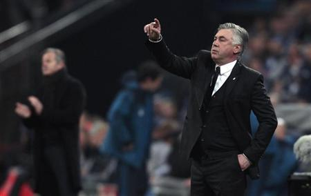 Real Madrid's coach Ancelotti gestures during their Champions League soccer match against Schalke 04 in Gelsenkirchen