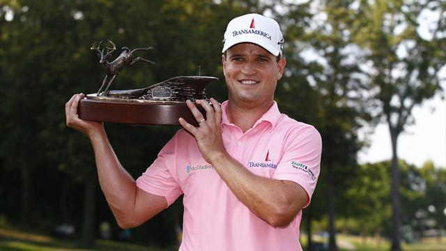 Golf - Johnson wipes slate clean for title defence