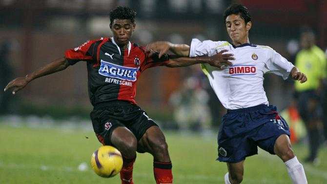 File photo of Castro of Colombia's Deportivo Cucuta battling for the ball with Navas of Mexico's Chivas during their Copa Libertadores soccer game in Cucuta
