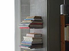 Invisible floating bookshelves dress up a corner in this home. Use it in your house for displaying…
