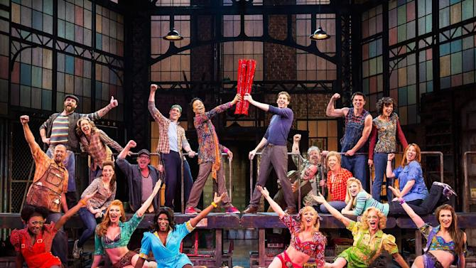 "This theater image released by The O+M Company shows the cast during a performance of the musical ""Kinky Boots."" The Cyndi Lauper-scored ""Kinky Boots,"" based on the 2005 British movie about a real-life shoe factory that struggles until it finds new life in fetish footwear, is nominated for 13 Tony Award nominations. The awards will be broadcast on CBS from Radio City Music Hall on June 9. (AP Photo/The O+M Company, Matthew Murphy)"