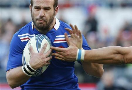 France's Michalak is tackled by Italy's Minto during their Six Nations rugby match at the Olympic stadium in Rome