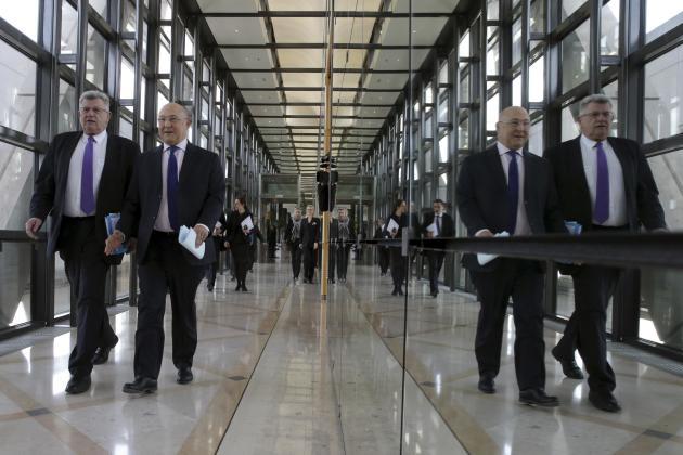 French junior Budget minister Eckert and Finance minister Sapin arrive at a press conference at the Ministry in Paris