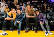 Indeed, David has now revealed which of his sons is the most fashion-forward. 'We used to try to dress them up, but now they want to wear their own things,' the hunky footballer says. 'Brooklyn will just wear his soccer shirts and T-shirts, but Romeo is the fashion one, so he'll go