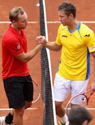 Belgian Steve Darcis (L) shakes hands with Swedish Michael Ryderstedt after winning the first match of the Davis Cup World Group play-off, at the Royal Primerose Tennis Club in Brussels. Belgium are one win away from ending Sweden's 12-year stay in the World Group after opening a 2-0 lead in Brussels