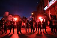 """Members of the Greek extreme right wing Golden Dawn Party celebrate outside their office in Thessaloniki. Greek neo-Nazi party Golden Dawn warned rivals and reformers Sunday that """"the time for fear has come"""" after exit polls showed them securing their entry in parliament for the first time in nearly 40 years"""