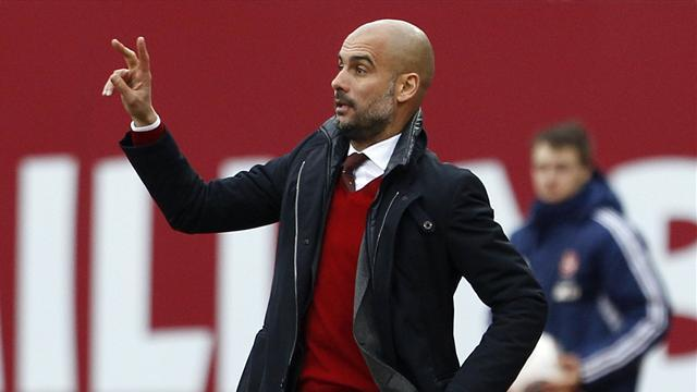 Football - Guardiola dismisses United link, reaffirms his loyalty to Bayern