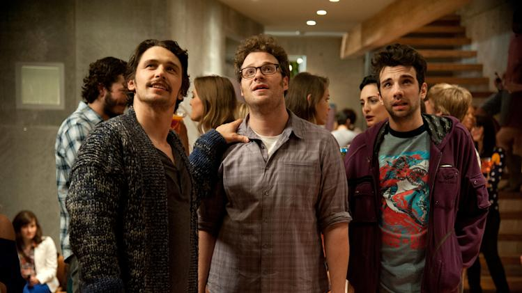 "FILE - This file film publicity image released by Columbia Pictures shows, from left, James Franco, Seth Rogen and Jay Baruchel in a scene from ""This Is The End."" Since the film's opening, the apocalyptic comedy ""This Is the End"" has earned $33 million at the box office, making it one of the biggest hit comedies of the year. But despite its name, the rapture riot by writer-directors Seth Rogen and Evan Goldberg struggled to find its conclusion, and even had to reshoot the film's final absurdist minutes. (AP Photo/Columbia Pictures - Sony, Suzanne Hanover, File)"