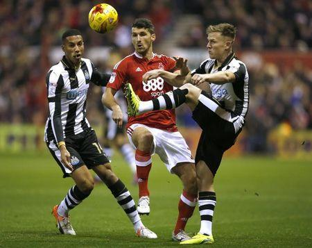 Newcastle's Matt Ritchie and Isaac Hayden in action with Nottingham Forest's Eric Lichaj