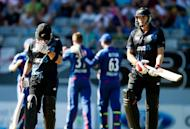 New Zealand's Brendon McCullum (L) hides his face as team-mate Kane Williamson walks off after being caught during the third one-day international against England Auckland on February 23, 2013. New Zealand cumbled to 185 all out at Eden Park