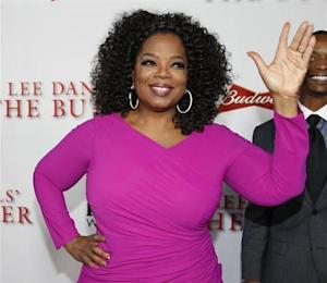 "Actress Oprah Winfrey, a cast member of the film ""Lee Daniels' The Butler"", poses at the film's premiere in Los Angeles"