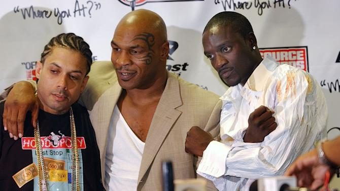 "FILE - In this Oct. 10, 2004 file photo, Ray Benzino, left, from Source Magazine, Mike Tyson and Akon pose for a photo at the Source Hip Hop Awards ceremony in Miami. Benzino says reports were overblown about a massive brawl that included ""Love & Hip Hop: Atlanta"" cast members during a recent filming of the VH1 reality show. Benzino, whose real name is Raymond Scott, said in an interview Friday, Feb. 8, 2014, that the incident was an ""isolated"" matter. He said the argument started between his former girlfriend Karli Redd and his fiance, Althea Hart. The incident occurred late Wednesday night during the opening of a new nightclub located in downtown Atlanta, owned by Benzino and Stevie J, the Grammy-winning record producer who also stars on the hit reality show. (AP Photo/J.Pat Carter)"