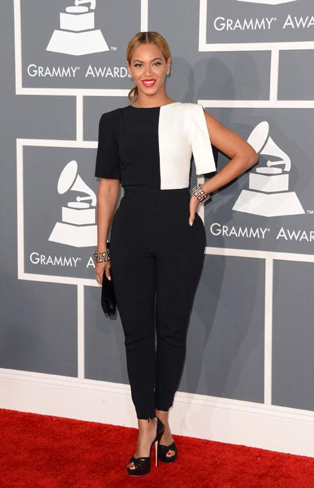 It seems that Beyoncé is taking the infamous Grammy memo to heart. The sexy Superbowl halftime singer surprises everyone by covering up her curves in a black and white colour block pantsuit. We hope t